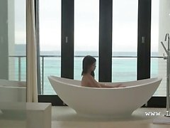 Dildoing her sweet snatch in the jacuzzi