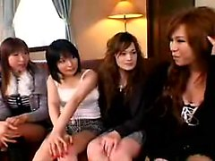 Beautiful Oriental babe has a group of girls peeling off he