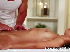 Oiled babe gets pussy creampie from masseur