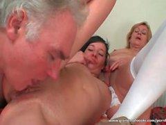Granny enjoys hot threesome with sexy slut