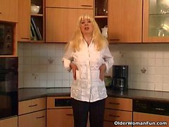 Blonde granny fucks herself on the kitchen floor
