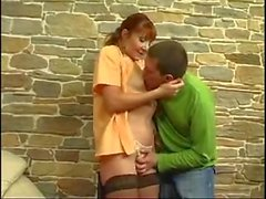 Redhead cleaning MILF in stockings likes the attention