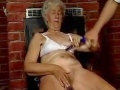 Grandma plays with some dildos