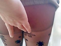 As in patterned black pantyhose
