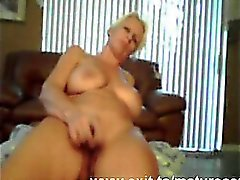 55 years blonde Judith toying on home webcam