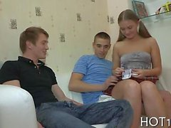 brunette is having fun in this threesome