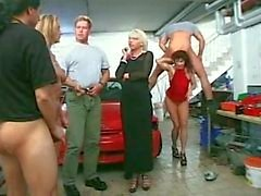 piss party in a car garage