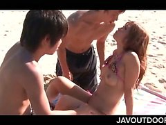 Stunning jap teen in swim suit shared by two guys at the beach