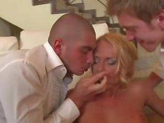 Amazing blonde fucks two hard cocks