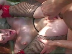 Easy redhead in red latex boots gets some double penetrated in the park