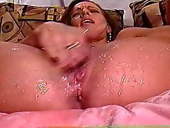 amateur rubs pussy makes it squirt