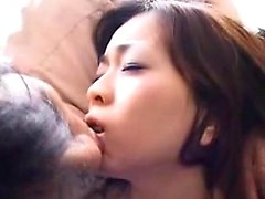 Adorable Japanese babe gets passionately kissed by a horny
