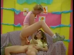 Two pigtailed babes toying each other