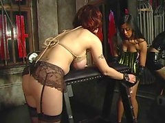 Sexy dominatrix tortures a sexy brunette with enormous titts