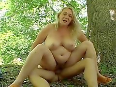 mature fucked in the forest