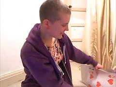 Shaved headed British girl plays with her big tricks