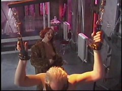 Mature redhead lingerie clad dominatrix whips older white guy in her lair