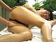 Beautiful Oriental lady gets her lovely body greased up and