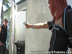 African transsexual in a latex dress receives head