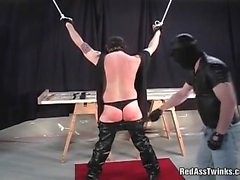 Kinky masked guy spanked nasty gay dude till his butt turns