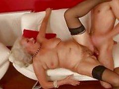 Lusty busty granny fucking with a boy