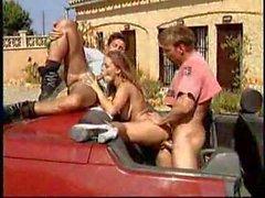 Busty blonde Lydia Pirelli threesome in a car M22