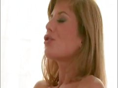 Two hot babes share a cock and each other in this sexy threesome