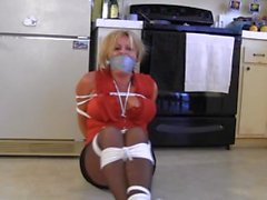 Cleo dragged in her kitchen, bound and tape gagged!