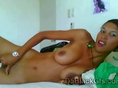 Sleazy ebony girlfriend with hot jugs masturbates through web cam