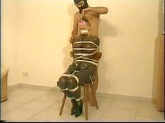 Blonde is bound and gagged and tied to a chair as master plays