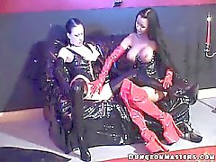 Sensuous lesbian slave Hilbel gets latex gloves licked and sucked by a hot mistress