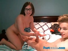 Teen couple playing in bed at webcam