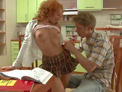 Redhead Avina gets anal sex in kitchen
