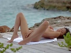 Asian angel fingering by the ocean