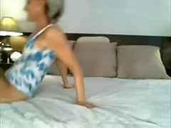 Sexy mature inserts a gadget up her butt on livecam
