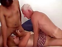 Mature couple with neighbor lad