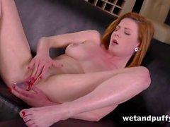 Sexy redhead babe in a seductive solo scene