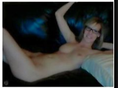 Blonde college coed in glasses is on her webcam rubbing her slit