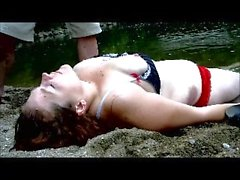 Young Busty Topless Redhead Gets CPR Done Outside By The River