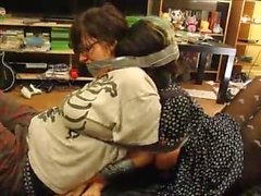 Two girls wrap gagged and bound together
