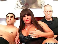 Busty milf gets facial in threesome