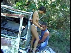 Brunette with nice tits sucks white dude's big cock outdoors then fucks