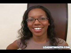 Ebony in glasses poses and then sucks on a big white cock with cum