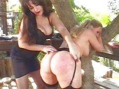 Mistress spanking slave girl until she obeys