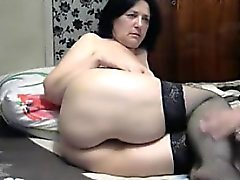 Naughty mature woman in black stockings puts her big booty