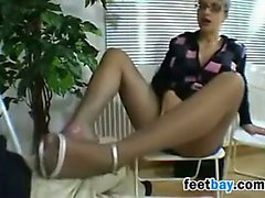 A Footjob With Nylons And High Heels On