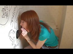 Pale freckled Redhead sucks through a Gloryhole