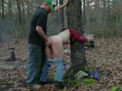 helpless tied to a tree