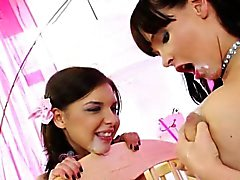 Playfull teens feed eachother with milk in a roleplay