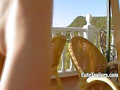 Petite teen toying cunt on the balcony